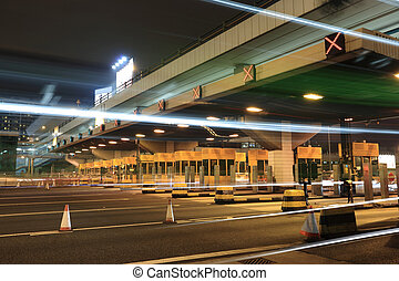 toll booths with car light in Hong Kong