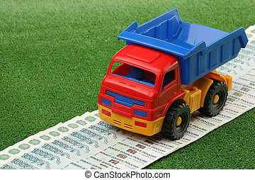 Toy truck and russian money on a green background