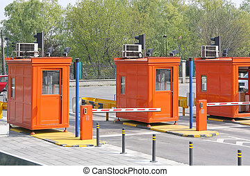 Toll collection booth with barrier