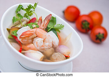 Tom Yum Goong spicy soup with shrimp, thai food with ingredient f