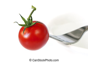 Tomato and Fork on Bowl
