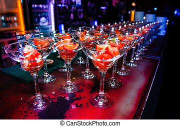 tomato appetizer in glasses in a row