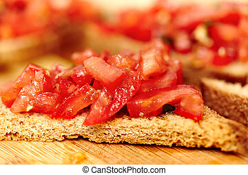 Tomato bruschetta on a wooden board