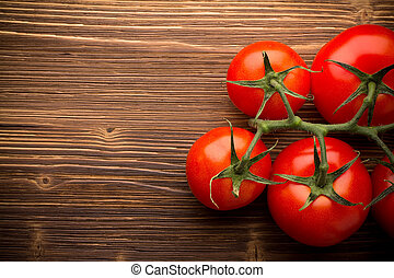Tomato bunch. - Tomato bunch on a wooden background.