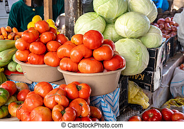 Tomato, cabbages and other vegetables in the market.