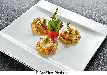 Tomato cake on white plate in restaurant