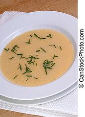 tomato cream soup in a white bowl
