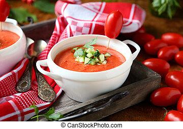tomato cream soup in a white tureen