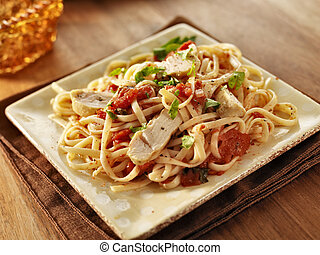 tomato herb linguine with grilled chicken slices