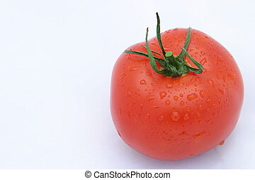 Tomato Horizontal - A perfect, red tomato against a white...