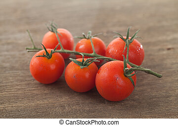 Tomato isolated in wood background