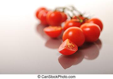 tomato isolated tomato isolated - small wet fresh red tomato...