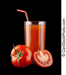 tomato juice in a glass and tomatoes on a black background