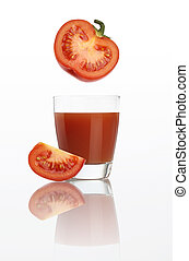 tomato juice in glass isolated on white background