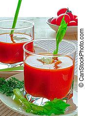 Tomato juice in two glasses.