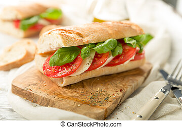 Fresh tomato mozzarella baguette with fresh basil