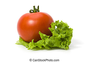 Tomato on a leaf of lettuce isolated