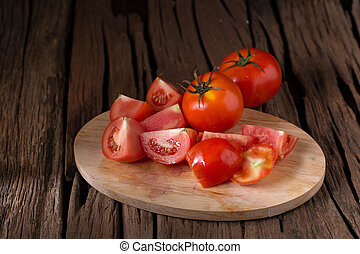 Tomato on a wooden background
