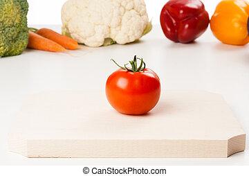 tomato on cutting board