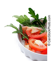 tomato salad with arugula in a white cup