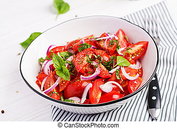 Tomato salad with basil and red onions. Homemade food....
