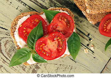 Tomato sandwich - Tomato and basil summer sandwich.