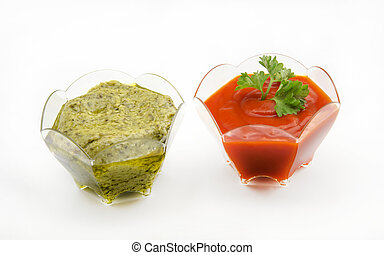 Tomato sauces and guacamole on white background