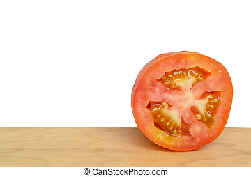 Tomato slice isolated on wood table with white background