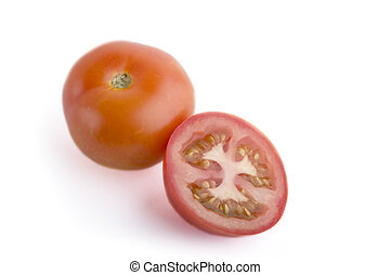 Tomato Sliced - A sliced tomato on a white background
