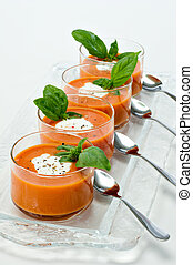 Tomato Soup Appetizer - Four small glass bowls filled with...