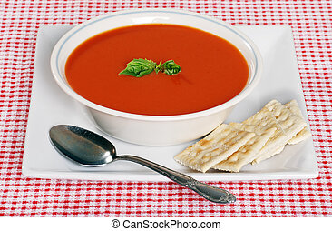 tomato soup in a bowl with basil