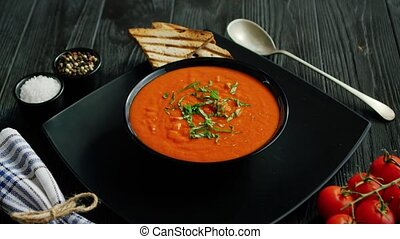 Tomato soup in bowl with crisp bread - From above view of ...