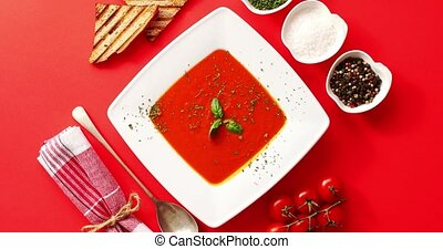 Tomato soup served in plate with spoon - From above view of...