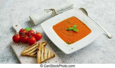 Tomato soup served with crisp bread - From above view of...