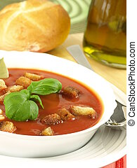 Tomato soup with croutons and bread