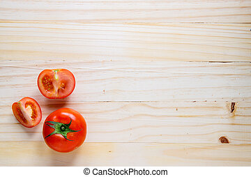 tomato, top view on wood background