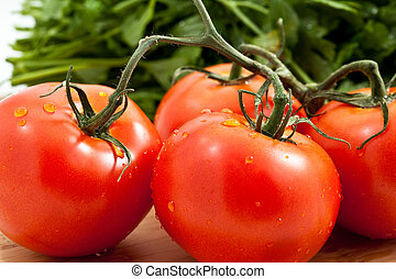 Tomato with parsely - fresh tomatoes tomatoes on a bamboo ...