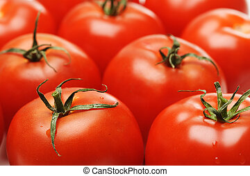 Tomatoes - A close up shots of a bunch of tomatoes