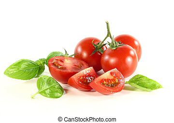 Tomatoes and basil - a handful of tomatoes and basil on...