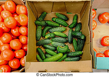 Tomatoes and cucumbers in market