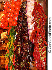 Tomatoes and dry peppers in a traditional market - Tomatoes...