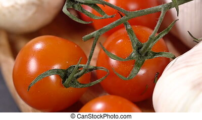 Tomatoes and garlic close-up - Tomatoes and garlic on the...