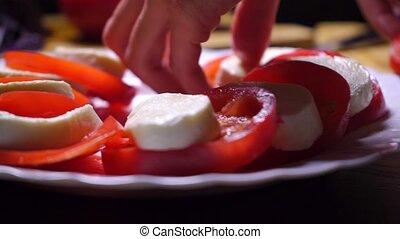 Tomatoes and mozzarella cheese salad close up video clip