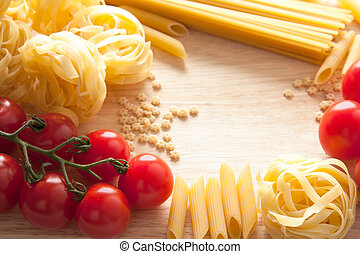 Tomatoes and pasta with copyspace - Ripe red cherry tomatoes...