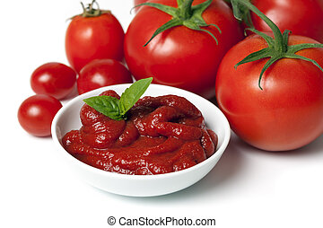 Tomatoes and Tomato Puree - Whole tomatoes with dish of ...