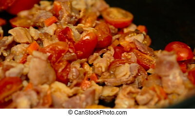 tomatoes bacon onion carrots in a pan