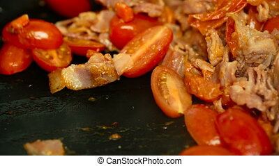 tomatoes bacon onion carrots in a pan closeup