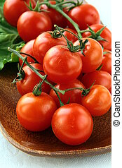 Tomatoes Cherry on wooden board