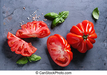 Tomatoes Coeur De Boeuf. Beefsteak tomato - Whole and sliced...