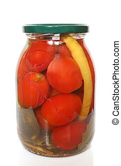 Tomatoes, cucumbers and pepper canned in glass jar